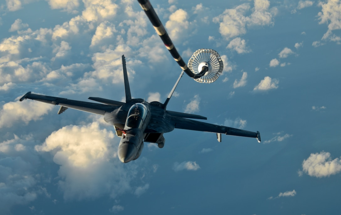 A KC-10 Extender from Travis Air Force Base, California, prepares to refuel another KC-10 over the Pacific Ocean July 14, 2017. KC-10s from Travis AFB supported Exercise Talisman Saber 2017 by conducting various air refueling missions over Australia. TS17 is a biennial exercise in Australia that focuses on bilateral military training between U.S. Pacific Command forces and the Australian Defence Force to improve U.S.-Australia combat readiness, increase interoperability, maximize combined training opportunities and conduct maritime prepositioning and logistics operations in the Pacific. (U.S. Air Force photo by 2nd Lt. Sarah Johnson)