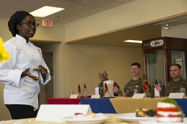 U.S. Marine Corps Sgt. Ayesha L. Zantt, a food service specialist with Headquarters and Headquarters Squadron (H&HS), talks about a meal she prepared for the Food Service Specialist of the Quarter competition at Marine Corps Air Station Iwakuni, Japan, July 13, 2017. The event prepared Marines for a larger competition July 26-27 in Okinawa.Zantt answered questions the judges had about her food and the flavors she used in each of her recipes. (U.S. Marine Corps photo by Lance Cpl. Gabriela Garcia-Herrera)