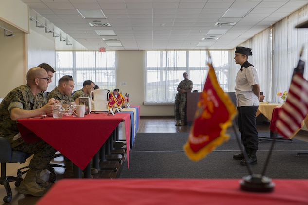 U.S. Marine Corps Lance Cpl. Erika Vargas, a food service specialist with Headquarters and Headquarters Squadron, answers questions for the judges during the Food Service Specialist of the Quarter competition at Marine Corps Air Station Iwakuni, Japan, July 13, 2017. The event prepared Marines for a larger competition July 26-27 in Okinawa. This was Vargas' second time participating in the competition. She took first place, surpassing her placement last quarter. (U.S. Marine Corps photo by Lance Cpl. Gabriela Garcia-Herrera)