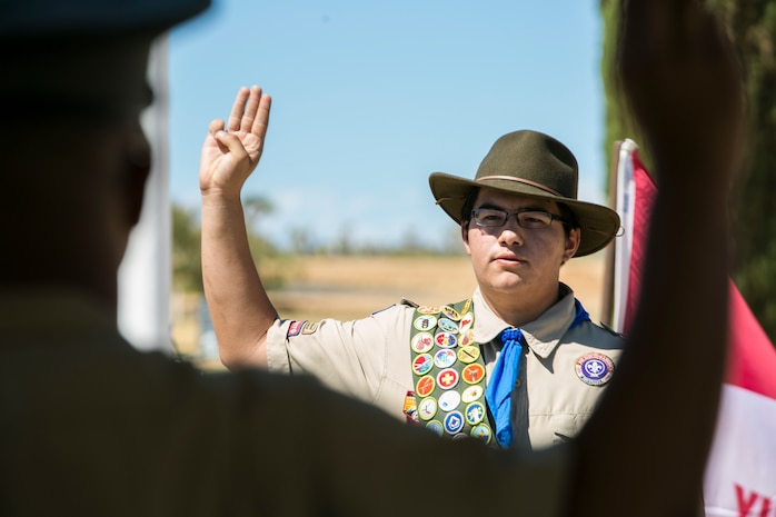 Robert Latham, boy scout, Troop 309, takes part in the Scout's Oath during a memorial dedication ceremony for the Boy Scout of America in Mountain Valley Memorial Park in Joshua Tree, Calif., July 4, 2017. Capt. Jason Samuel, defense counsel, Legal Services Support Team, Headquarters Battalion, served as the guest speaker for the ceremony. Samuel was a boy scout for several years prior to joining the Marine Corps. (U.S. Marine Corps photo by Lance Cpl. Isaac Cantrell)