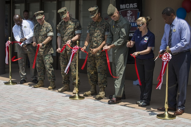 Marine Corps Air Station Iwakuni's command came to the Single Marine Program's (SMP) Marine Lounge grand opening to support the SMP and help the coordinators cut the ribbon at Marine Corps Air Station Iwakuni, Japan, July 14, 2017. Originally located on the second floor, over Crossroads Mall, the Marine Lounge was moved to make it more available to single and unaccompanied service members on the air station. (U.S. Marine Corps photo by Lance Cpl. Gabriela Garcia-Herrera)