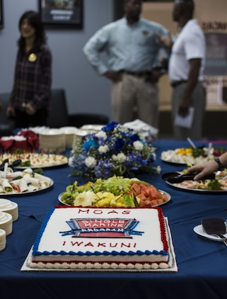 A cake sits on display at the Single Marine Program's Marine Lounge grand opening at Marine Corps Air Station Iwakuni, Japan, July 14, 2017. Originally located on the second floor over Crossroads Mall, the Marine Lounge was moved to make it more available to single and unaccompanied service members on the air station. During the event, people participated in a video game tournament, sumo tournament, karaoke contest, watched a movie marathon and took part in other amenities the lounge offered. (U.S. Marine Corps photo by Lance Cpl. Gabriela Garcia-Herrera)