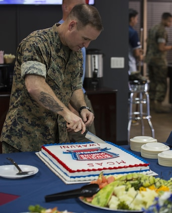 U.S. Marine Corps Sgt. Maj. Christopher J. Garza, sergeant major of Marine Corps Air Station (MCAS) Iwakuni, cuts the cake during the Single Marine Program's (SMP) Marine Lounge grand opening at MCAS Iwakuni, Japan, July 14, 2017. Originally located on the second floor over Crossroads Mall, the Marine Lounge was moved to make it more available to single and unaccompanied service members on the air station. Garza attended the event to cut the ribbon, slice the cake and support the SMP. (U.S. Marine Corps photo by Lance Cpl. Gabriela Garcia-Herrera)