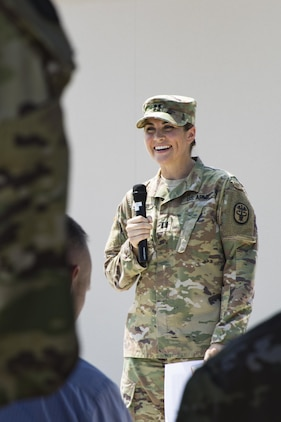 U.S. Army Capt. Monika Jones, branch chief, Iwakuni Veterinary Services, Public Health Activity Japan, gives a speech during the opening of the new veterinary clinic at Marine Corps Air Station Iwakuni, July 13, 2017. The new facility was built to accommodate the growing number of patients and military working dogs on the air station. The veterinary clinic is responsible for the welfare of hundreds of military pets and military working dogs, and the new facility allows technicians to double the amount of patients they can see. (U.S. Marine Corps photo by Cpl. Joseph Abrego)