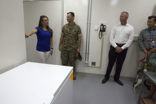 Veterinary clinic personnel showcase the new facility for guests during the opening of the veterinary clinic at Marine Corps Air Station Iwakuni, Japan, July 13, 2017. The veterinary clinic is responsible for the welfare of hundreds of military pets and military working dogs. The new facility allows technicians to double the amount of patients they can see. (U.S. Marine Corps photo by Sgt. N.W. Huertas)