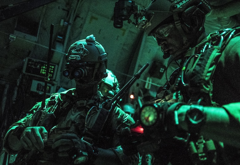 U.S. Air Force 320th Special Tactics Squadron jumpmasters prepare for high altitude, high opening (HAHO) jump operations July 11, 2017, over Shoalwater Bay Training Area in Queensland, Australia during Talisman Saber 2017. The 320th STS combat controllers and U.S. Marine Corps 3rd Reconnaissance Battalion operators infilled two days prior to the exercise's massive tactical (MASS TAC) airdrop of 500 jumpers in order to establish the drop zone. (U.S. Air Force photo by Capt. Jessica Tait)