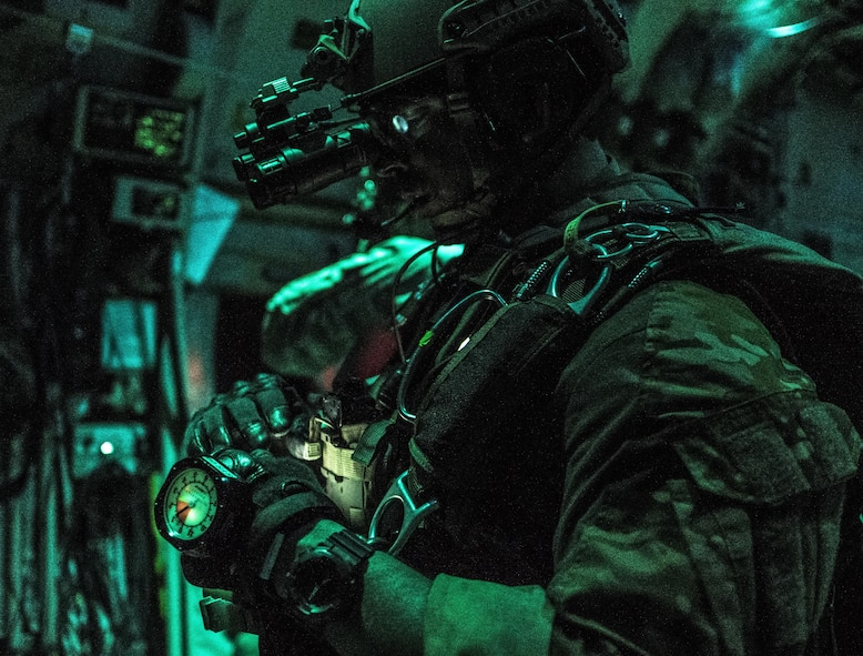 A U.S. Air Force 320th Special Tactics Squadron jumpmaster inspects his gear prior to high altitude, high opening (HAHO) jump operations July 11, 2017, over Shoalwater Bay Training Area in Queensland, Australia during Talisman Saber 2017. The 320th STS combat controllers and U.S. Marine Corps 3rd Reconnaissance Battalion operators infilled two days prior to the exercise's massive tactical (MASS TAC) of 500 jumpers in order to establish the drop zone. (U.S. Air Force photo by Capt. Jessica Tait)