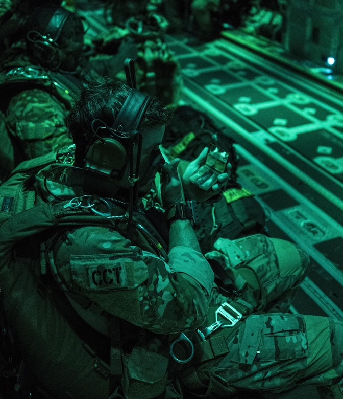A U.S. Air Force 320th Special Tactics Squadron jumpmaster applies face paint prior to high altitude, high opening (HAHO) jump operations July 11, 2017, at Rockhampton, Australia during Talisman Saber 2017. The infiltration of 320th STS combat controllers and U.S. Marine Corps 3rd Reconnaissance Battalion operators served as the first stage to the exercise's massive tactical (MASS TAC) airdrop of 500 jumpers over Shoalwater Training Area in Queensland, Australia. (U.S. Air Force photo by Capt. Jessica Tait)