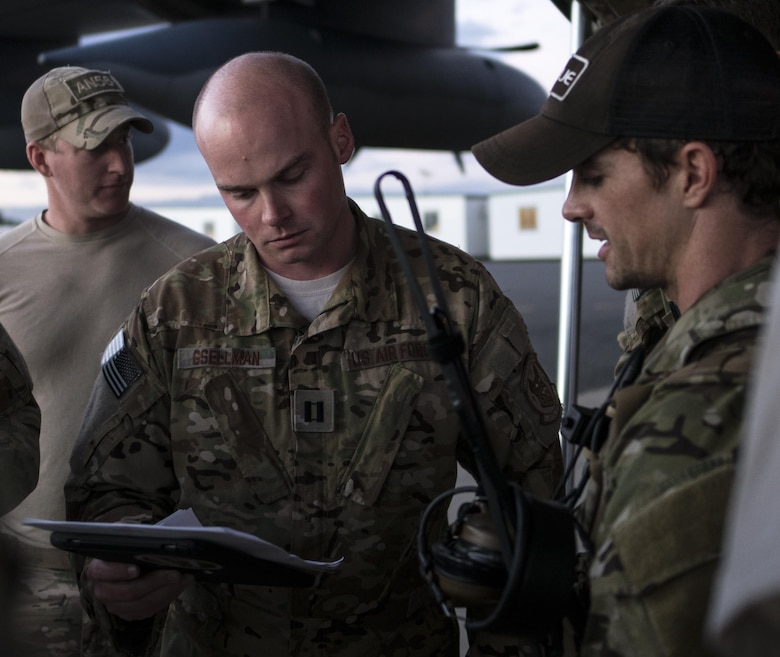 A U.S. Air Force 17th Special Operations Squadron MC-130J Commando II aircraft commander and 320th Special Tactics Squadron jumpmaster discuss the parameters for high altitude, high opening (HAHO) jump operations July 11, 2017, at Rockhampton, Australia during Talisman Saber 2017. Experts in specialized aviation, the 17th SOS executed complex personnel and cargo airdrops, low-level flying operations and dissimilar formation flights with 37th Squadron Royal Australian Air Force and 40th Squadron Royal New Zealand Air Force throughout the exercise. (U.S. Air Force photo by Capt. Jessica Tait)