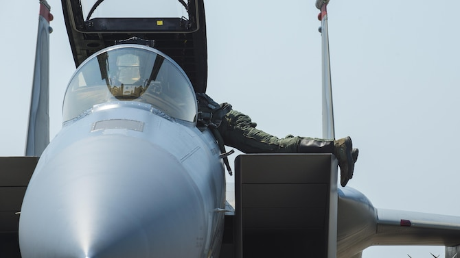A U.S. Air Force F-15C Eagle pilot reaches into the cockpit after arriving at Misawa Air Base, Japan, June 7, 2017. Pilots and maintainers relocated from Kadena Air Base, Japan, to Misawa to conduct joint and bilateral operations with F-16 Fighting Falcons and the Japan Air Self-Defense Force's F-2s. (U.S. Air Force photo by Staff Sgt. Deana Heitzman)