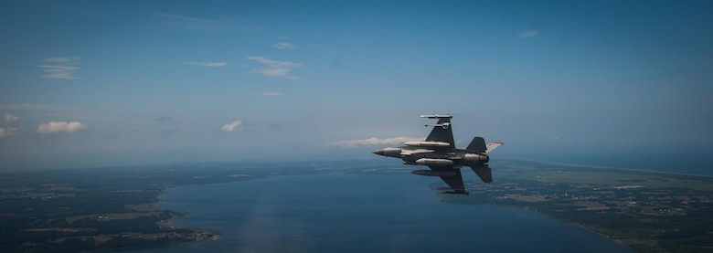 U.S. Air Force Capt. David Neville, a 13th Fighter Squadron F-16 Fighting Falcon pilot, banks right during a flight across Northern Japan, June 12, 2017. Neville and other 13th and 14th Fighter Squadron pilots joined Kadena Air Base, Japan, F-15C Eagle pilots to conduct air-to-air coverage and suppression of enemy air defense procedures during an aviation relocation training. (U.S. Air Force photo by Staff Sgt. Deana Heitzman)