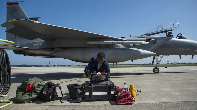 U.S. Air Force Senior Airman Devin Ross, an 18th Aircraft Maintenance Squadron crew chief, conducts preflight procedures prior to an F-15C Eagle flight at Misawa Air Base, Japan, June 13, 2017. Due to its strategic location in northern Japan, Misawa AB is a hub for contingency operations for airframes and units forward deployed across the Indo-Asia-Pacific region. It is important during trainings like these to test the abilities of the pilots and maintainers who work alongside the aircraft. Ross is assigned to Kadena Air Base, Japan. (U.S. Air Force photo by Staff Sgt. Deana Heitzman)