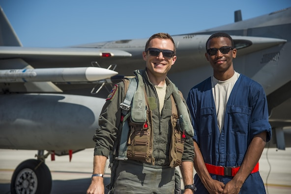 U.S. Air Force Capt. David Kuhn, left, a 67th Fighter Squadron F-15C Eagle pilot, and Senior Airman Devin Ross, right, an 18th Aircraft Maintenance Squadron crew chief, pause for a photo prior to flight at Misawa Air Base, Japan, June 13, 2017. Pilots and maintainers from Kadena AB, Japan, relocated to Misawa AB, due to its strategic location, ensuring contingency operations for airframes and units forward deployed across the Indo-Asia-Pacific region. (U.S. Air Force photo by Staff Sgt. Deana Heitzman)