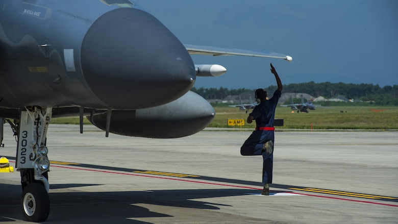 U.S. Air Force Senior Airman Devin Ross, an 18th Aircraft Maintenance Squadron crew chief, taps the wing of an F-15C Eagle prior to taxi at Misawa Air Base, Japan, June 13, 2017. Airmen and pilots from Kadena Air Base, Japan, and the 35th Fighter Wing, worked closely with Japan Air Self-Defense Force pilots to strengthen their bilateral partnership across the Indo-Asia-Pacific region. (U.S. Air Force photo by Staff Sgt. Deana Heitzman)