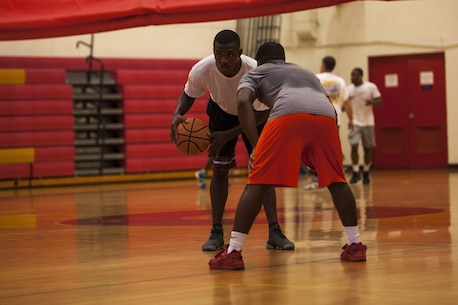 Cpl. Zachary Orr, a mass communicator with Headquarters Battalion, competes in the basketball tournament at the Semper Fit gym aboard Marine Corps Base Hawaii on July 12, 2017. The 101 Days of Summer program is a way of keeping Marines in Sailors physically fit while encouraging summer safety. (U.S. Marine Corps photo by Lance Cpl. Matthew Kirk)
