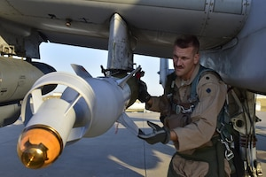 Lt. Col. Ben Rudolphi, 407th Expeditionary Operation Support Squadron commander, conducts a preflight munitions check on an A-10 Thunderbolt II July 11, 2017, at Incirlik Air Base, Turkey. Rudolphi has provided a dual role in Operation INHERENT RESOLVE as the commander of the 407th EOSS in Southwest Asia and being directly in the fight against ISIS conducting A-10 flying missions with the 477th Air Expeditionary Group.The A-10 supports ground forces with rapid employment close air and contact support. It utilizes a variety of bomb, missiles and a 30mm GAU-8 seven-barrel Gatling gun. (U.S. Air Force photo by Senior Airman Ramon A. Adelan)