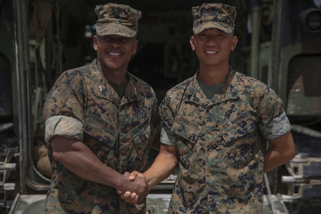 Sgt. Aenoi Luangxay ,right, a squad leader with Combat Engineering Company, 3rd Combat Assault Battalion, 3rd Marine Division, III Marine Expeditionary Force, receives a challenge coin July 7, 2017, in Okinawa, Japan, from Maj. Gen. Craig Timberlake, the 3rd Marine Division commanding officer, for winning the outstanding squad leader award while participating in the 2nd annual Marine Corps Combat Engineer Sapper competition held in Camp Pendleton, California. Luangxay was one of four squad leaders to be in the running for the award.