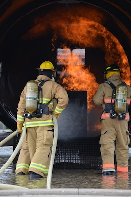 Firefighters from Army and Air National Guard units conduct interior aircraft rescue firefighter training to satisfy annual requirements during PATRIOT North 17 at Volk Field Combat Readiness and Training Center July 15, 2017. PATRIOT is a Domestic Operations disaster-response training exercise conducted by National Guard units working with federal, state and local emergency management agencies and first responders.