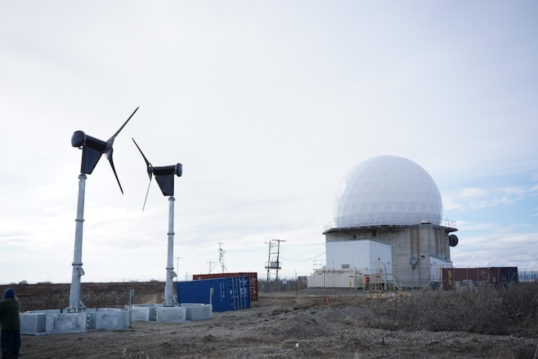 These energy-harvesting wind turbines in Kotzebue, Alaska, are part of the Energy Assurance at Remote Radar Sites project, a one-year effort managed by the AFRL Advanced Power Technology Office to demonstrate rapidly-deployable, off-grid energy technologies for increased mission energy resiliency in remote locations.  (U.S. Air Force photo/Capt Jason Goins)