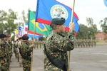 Multinational special forces teams line up at the opening ceremony for Fuerzas Comando 2017 in Mariano Roque Alonso, Paraguay on July 17, 2017. Fuerzas Comando is a fellowship program that promotes military-to-military relationships for all teams involved. (U.S. Army photo by Sgt. Christine Lorenz/Released)