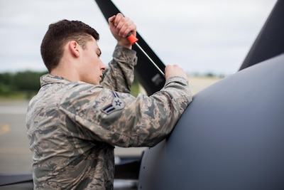Air Force Airman 1st Class Trevor Galindo, a crew chief for the Alaska Air National Guard's 176th Maintenance Squadron, removes a maintenance panel on an HC-130J Hercules aircraft at Joint Base Elmendorf-Richardson, Alaska, June 28, 2017. Alaska Air National Guard photo by Air Force Staff Sgt. Daniel Bellerive