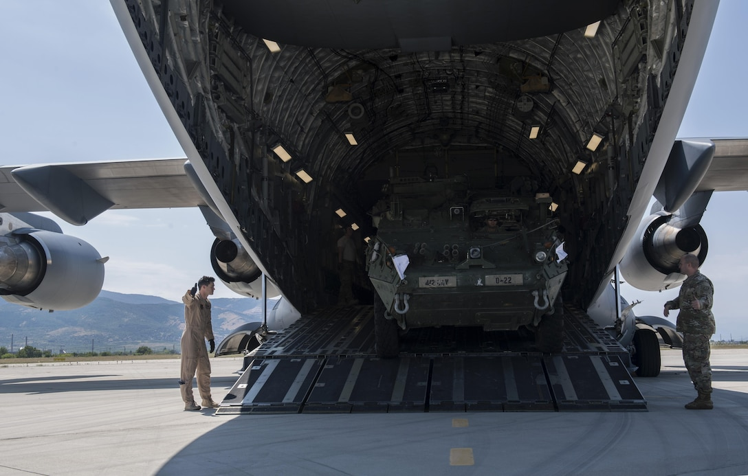 A U.S. Army 2nd Cavalry Regiment Interim Armored Vehicle Stryker drives out of a U.S. Air Force C-17 Globemaster III at Plovdiv Airport, Bulgaria, July 14, 2017. Delivering Stryker vehicles to Bulgaria is an example of how assets are ready and postured to assure, deter, and respond as a joint and combined team in the event a U.S. response is required. (U.S. Air Force photo by Senior Airman Tryphena Mayhugh)