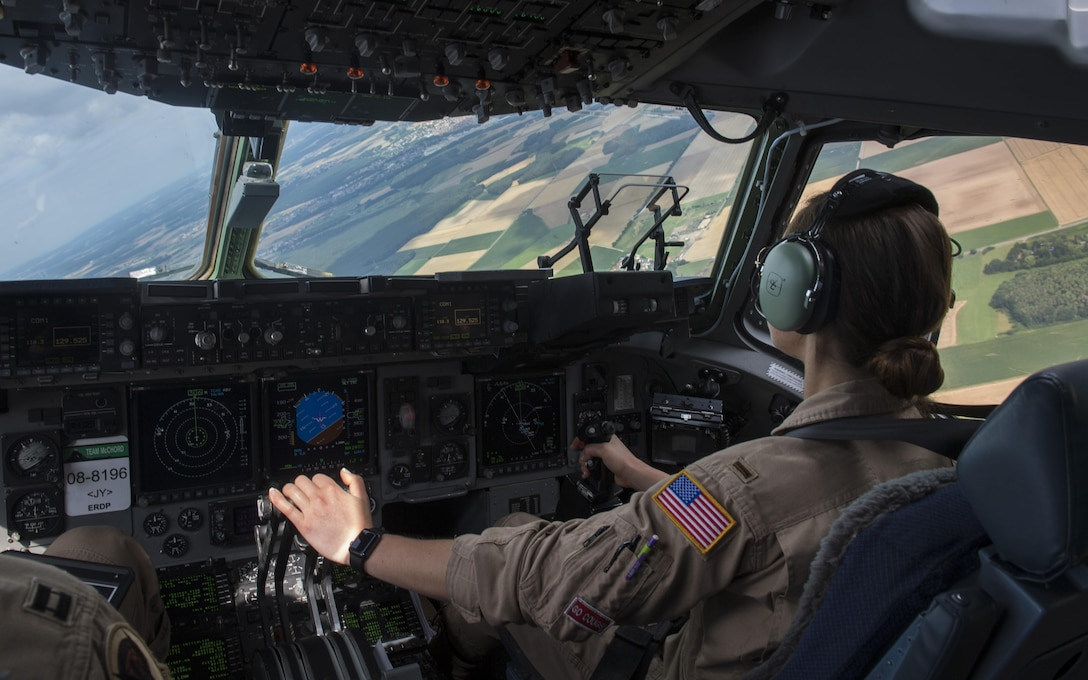 U.S. Air Force Reserve 2nd Lt. Reily Finnelly, 97th Airlift Squadron pilot, flies a C-17 Globemaster III to transport U.S. Army 2nd Cavalry Regiment Interim Armored Vehicle Strykers to Plovdiv Airport, Bulgaria, July 14, 2017. The U.S. Air Force's capability for rapid mobility allows U.S. and allied power to be projected quickly to anywhere on the globe. (U.S. Air Force photo by Senior Airman Tryphena Mayhugh)