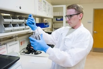 Staff Sgt. Douglas Turner, Non Commissioned Officer in Charge of laboratory services, prepares chemistry samples for analysis by placing them in the machine sample tray, July 17, 2017, at the medical clinic, Patrick Air Force Base, Fla. Lab technicians recently used the 45th Space Wing's Continuous Process Improvement program to redesign six processing areas at the medical clinic. At a weeklong Green Belt academics course they learned new tools and techniques to use in solving problems, improving processes and creating value for patients and physicians. (U.S. Air Force photo by Phil Sunkel)