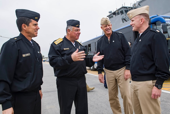 CALLAO, Peru (July 16, 2017) Peruvian navy Rear Adm. Alberto Alcala, commander, Surface Force Peru, left, Vice Adm. Fernando Cerdan, commander general of Pacific Operations, left center, Rear Adm. Sean S. Buck, commander, U.S. Naval Forces Southern Command/U.S. 4th Fleet, left center, and Master Chief Petty Officer of the Navy Steven S. Giordano, meet during an international cuisine festival as part of UNITAS 2017. UNITAS is an annual multinational exercise that focuses on strengthening our existing regional partnerships and encourages establishing new relationships through the exchange of maritime mission-focused knowledge and expertise throughout the exercise. (U.S. Navy photo by Mass Communication Specialist 2nd Class Bill Dodge/Released)