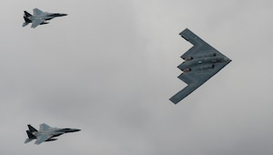 A U.S. Air Force B-2 Stealth Bomber and two F-15 Strike Eagle aircraft fly past spectators during the 2017 Royal International Air Tattoo (RIAT) located at RAF Fairford, United Kingdom, on July 16, 2017. This year commemorates the U.S. Air Force's 70th Anniversary, which was highlighted during RIAT by displaying its lineage and advancements in military aircraft. (U.S. Air Force photo by Tech. Sgt. Brian Kimball)
