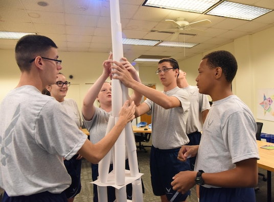 Raptor Flight cadets assemble a paper tower as they participate in a team building exercise during the Junior ROTC Cadet Leadership Course at the Mathies NCO Academy July 13, 2017, on Keesler Air Force Base, Miss. Approximately 140 JROTC students from 15 high schools in five states attended the week-long course at Keesler that ended with a parade and graduation ceremony. (U.S. Air Force photo by Kemberly Groue)