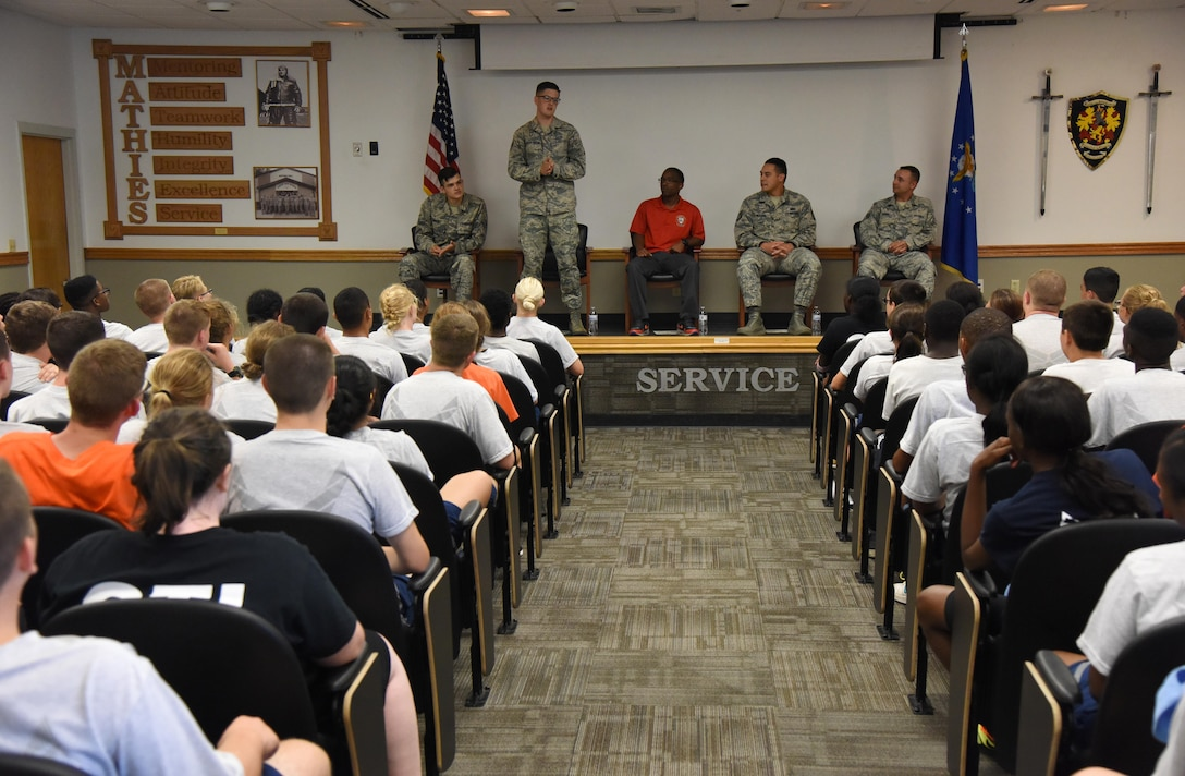 Senior Airman Dylan Sluder-Brehm, 81st Diagnostic and Therapeutics Squadron pharmacy vault custodian, speaks with Air Force Junior ROTC Cadets during an Airman panel during the JROTC Cadet Leadership Course at the Mathies NCO Academy auditorium July 13, 2017, on Keesler Air Force Base, Miss. Approximately 140 JROTC students from 15 high schools in five states attended the week-long course at Keesler that ended with a parade and graduation ceremony. (U.S. Air Force photo by Kemberly Groue)