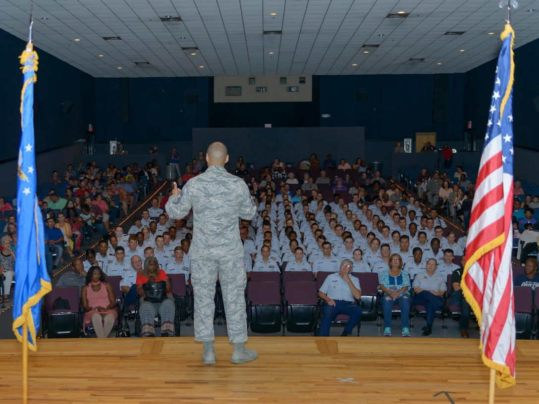 Chief Master Sgt. Rodney Deese II, Mathies NCO Academy commandant, speaks with Air Force Junior ROTC Cadets during the JROTC Cadet Leadership Course graduation at the Welch Theater July 14, 2017, on Keesler Air Force Base, Miss. Approximately 140 JROTC students from 15 high schools in five states attended the week-long course at Keesler that ended with a parade and graduation ceremony. (U.S. Air Force photo by André Askew)