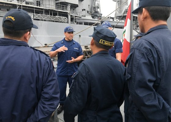 LIMA, Peru (July 16, 2917) - U.S. Coast Guard Maritime Enforcement Specialist 2nd Class Juan Leon conducts a maritime law enforcement symposium with UNITAS partner nation participants from Mexico, Peru, Honduras and Chile onboard a Peruvian naval vessel. UNITAS is an annual exercise that focuses on strengthening our existing regional partnerships and encourages establishing new relationships through the exchange of maritime mission-focused knowledge and expertise throughout the exercise. (U.S. Navy photo by Mass Communication Specialist 2nd Class Michael Hendricks/Released)
