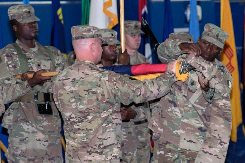 Maj. Gen. Blake C. Ortner, commanding general of the 29th Infantry Division, and Command Sgt. Maj. Ronald L. Smith, senior enlisted advisor, case the division colors during the Task Force Spartan transfer of authority ceremony, at Camp Arifjan, Kuwait, July 13, 2017. The 29th Infantry Division handed over control of TF Spartan, part of Operation Spartan Shield to the 35th Infantry Division. TF Spartan highlights the vital role played by Army National Guard and Army Reserve Soldiers in operations around the world.