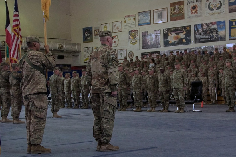 Soldiers and distinguished guests stand at attention in recognition of the national anthem during the Task Force Spartan transfer of authority ceremony, at Camp Arifjan, Kuwait, July 13, 2017. The 35th Infantry Division assumed command of Task Force Spartan, part of Operation Spartan Shield, from the 29th Infantry Division. TF Spartan highlights the vital role played by Army National Guard and Army Reserve Soldiers in operations around the world.