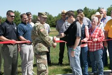 St. Louis District Deputy Commander Lt. Col. Ramon Mejia and Todd Shoemate, Mark Twain Lake FOREST Council vice president, cut a ribbon during a ribbon-cutting ceremony, May 31, 2017, for Mark Twain Lake's new archery range. The archery range has an ADA-compliant event target range and a 15-station archery trail. Completion of this range and trail was accomplished with a Handshake Partnership Program Grant, as well as donations of time, materials, and labor.