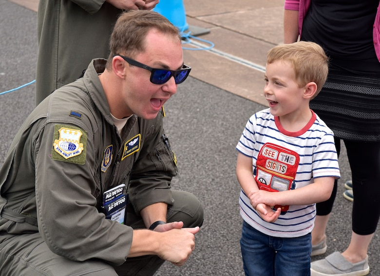1Lt Travis Carter talks with a young child at the Royal International Air Tattoo in Fairford, U.K.  A crew from the 315th Airlift Wing participated in the three-day airshow.  The airshow celebrated the 70th anniversary of the U.S. Air Force. (U.S. Air Force Photo by Maj. Wayne Capps)