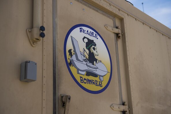 A decal is pictured on a Ground Control Station at Holloman Air Force Base, N.M. June 6, 2017. Under Col. Houston Cantwell, 49th Wing commander's initiative, Holloman's GCS yard is undergoing an artistic upgrade. This upgrade has led to the creation of 12 decals and application of 10 decals on the yard's GCSs. The decals, created in the spirit of World War II nose art, are used to raise morale among Holloman's Airmen. (U.S. Air Force photo by Airman 1st Class Alexis P. Docherty)