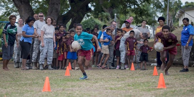 Two Fijian boys race against time during an obstacle course competition where they paired up with a U.S. service member on each team and fought the clock to get the whole team through the course before time ran out during a sports day community engagement activity at the Lautoka School for Special Education in Lautoka, Fiji, July 14, 2017. The service members are in Lautoka as part of Pacific Angel 2017 where they're working with the Fijian government to provide humanitarian assistance and subject matter expert exchanges July 11 to 24. (U.S. Air Force photo/Tech. Sgt. Benjamin W. Stratton)