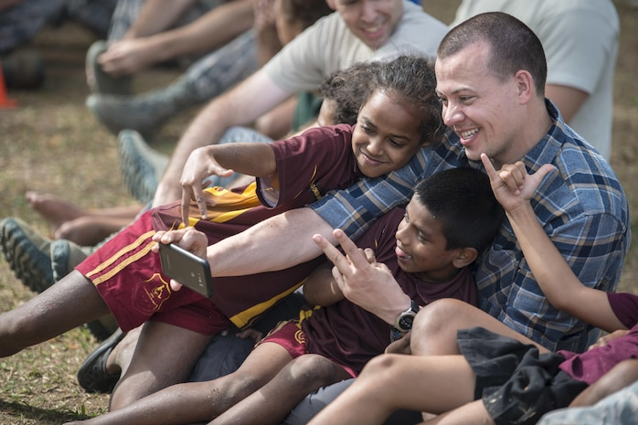 U.S. Air Force Maj. Scott Stewart, a pediatrician with the 673rd Medical Group at Joint Base Elmendorf-Richardson, Alaska, cuddles close with Fijian students while taking a selfie together during a sports day community engagement activity at the Lautoka School for Special Education in Lautoka, Fiji, July 14, 2017. Stewart is part of this year's Pacific Angel where he and more than 50 U.S. service members will join multilateral international participants from across the Indo-Asia-Pacific working together to assist the local community and improve capabilities among each other as one team. (U.S. Air Force photo/Tech. Sgt. Benjamin W. Stratton)