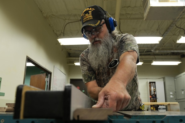 Ed Eick, 19th Force Support Squadron wood and frame shop worker, saws a slot in a piece of wood to allow glass to be placed inside, July 6, 2017, at Little Rock Air Force Base, Ark. Eick said that after 27 years in the military he puts a lot of heart and care into his work. (U.S. Air Force photo by Airman Rhett Isbell)