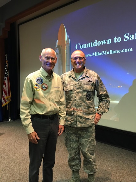 Mike Mullane, retired NASA astronaut and Air Force colonel, shares a photo opportunity with Maj. Gen. Andrew Mueller, chief of Air Force safety, during a visit at the Air Force Safety Center, Kirtland Air Force Base, N.M., on July 12, 2017.  As the featured speaker for the International Flight Safety Officer course conducted at AFSEC, Mullane discussed the normalization of deviance and its impact on risk management, the safety management culture and human factors as they relate to safety. (U.S. Air Force photo by Fred Harsany)