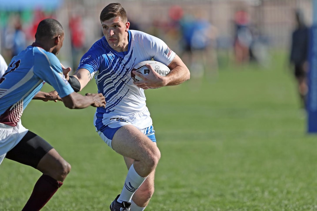 Austin, 29th Intelligence Squadron fusion analyst and U.S. Air Force Rugby player, stiffs arms a West Indies National Team defender during the Las Vegas Invitational Tournament in March 2017. (Courtesy photo)