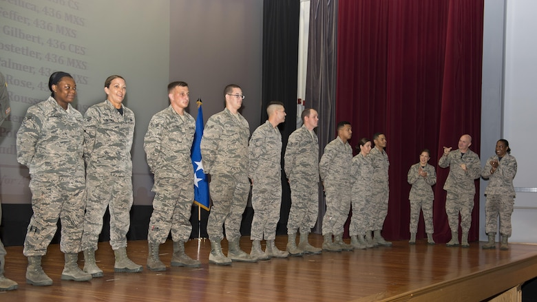 Gen. Carlton D. Everhart II, Air Mobility Command commander, and Chief Master Sgt. Shelina Frey, AMC command chief, surprise 11 Airmen with Below-the-Zone senior airman promotions July 14, 2017, at Dover Air Force Base, Del. These promotions allow the Airman to promote six months early. (U.S. Air Force photo by Senior Airman Zachary Cacicia)