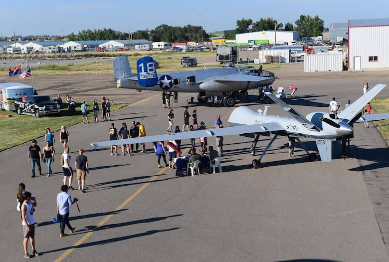Spectators gather around the MQ-9 Reaper to learn about its capabilities July 15, 2017, at the Lethbridge International Air Show in Alberta, Canada. The MQ-9 made its international debut over the weekend. (U.S. Air Force photo/Senior Airman Christian Clausen)
