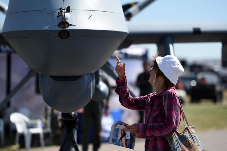 A Canadian citizen looks at the MQ-9 Reaper July 15, 2017, during the Lethbridge International Air Show in Alberta, Canada. The MQ-9 Reaper was on display as part of the partnership efforts between the U.S. and Canada. Airmen briefed spectators on the Reaper's multi-role capabilities, its maintenance and munitions specifications. (U.S. Air Force photo by Master Sgt. Nadine Barclay)