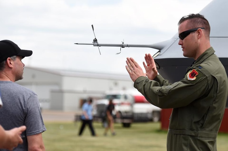 1st Lt. Daniel, 432nd WG pilot, explains the mission sets of the MQ-9 Reaper to Canadian residents at the Lethbridge International Air Show July 14-16, 2017, in Alberta, Canada. During the event, Canada residents asked many questions regarding the capabilities of the aircraft, but most were surprised by the multi-role platform and its various uses. 