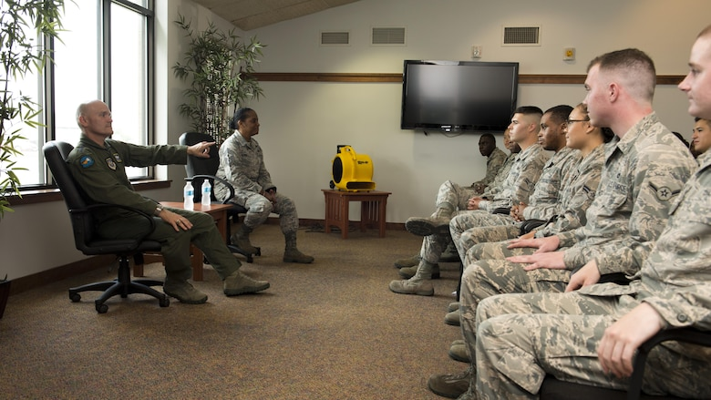 Gen. Carlton D. Everhart II, Air Mobility Command commander, and Chief Master Sgt. Shelina Frey, AMC command chief, meet with Team Dover Airmen who live in the base dormitories, July 13, 2017, at Dover Air Force Base, Del. This meeting allowed the Airmen to speak candidly with Everhart and Frey on their needs as Airmen. (U.S. Air Force photo by Senior Airman Zachary Cacicia)