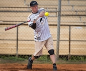 George Adams, 359th Training Squadron softball team, swings for the fences during an intramural game against the 96th Maintenance Squadron team July 17 at Eglin Air Force Base, Fla.  The league-leading Maintainers pounded the training squadron 10-5 to improve to 9-1 on the season.  (U.S. Air Force photo/Samuel King Jr.)